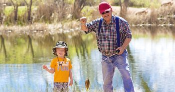 grandfather and grandson fishing image