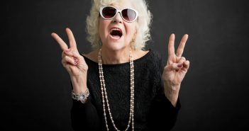 Grandma wearing sunglass with peace sign