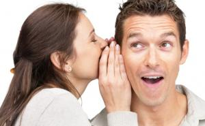 woman whispering to his partner