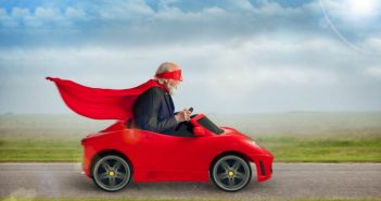 Grandpa with redcoat riding on the car