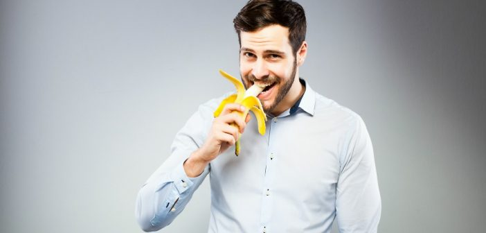 Man eating banana