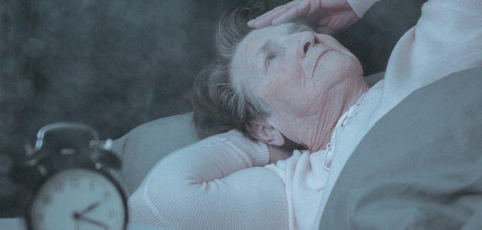 senior lying on her bed