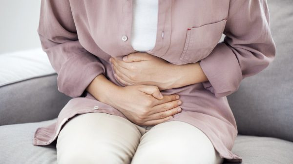 Woman experiencing stomach pain