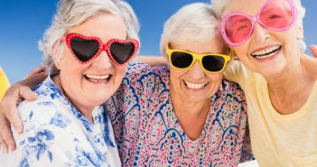 seniors wearing shades at the beach