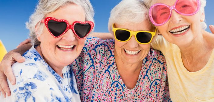seniors wearing shades at the beach