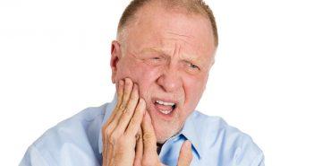 Senior man having a tooth ache