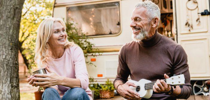 Senior man playing ukalele to his wife