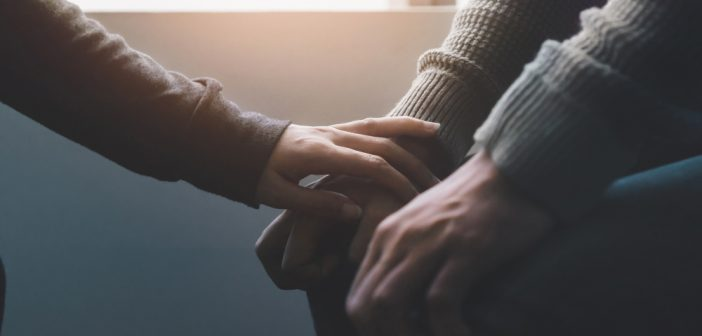 Psychologist sitting and touching hand